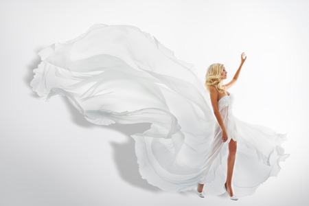 Photo for Woman White Waving Dress, Showing Hand Up, Flying Fabric, Silk Cloth Flowing on wind - Royalty Free Image