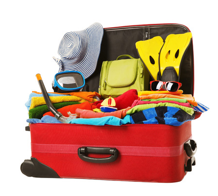 Foto de Suitcase Packed to Vacation, Open Red Luggage Full of Clothes, Family Travel Items Baggage, Trip Concept - Imagen libre de derechos