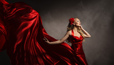 Photo for Model in Red Dress, Glamour Woman Posing in Flying Long Silk Cloth on Wind, Beauty Fashion Portrait - Royalty Free Image