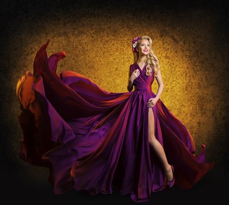 Photo pour Model in Purple Dress, Woman Posing in Flying Silk Cloth Waving on Wind, Beauty Fashion Portrait - image libre de droit
