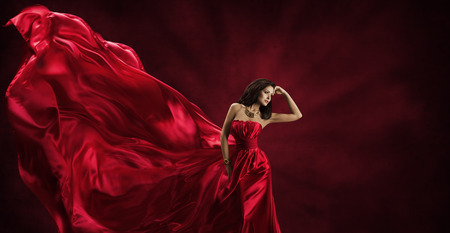 Photo for Red Dress, Woman in Flying Fashion Silk Fabric Clothes, Model Posing with Blowing Waving Cloth, Beauty Concept - Royalty Free Image