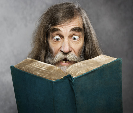 Photo for Senior Old Man Read Book Amazing Face Crazy Shocked Eyes Confused Surprised People - Royalty Free Image