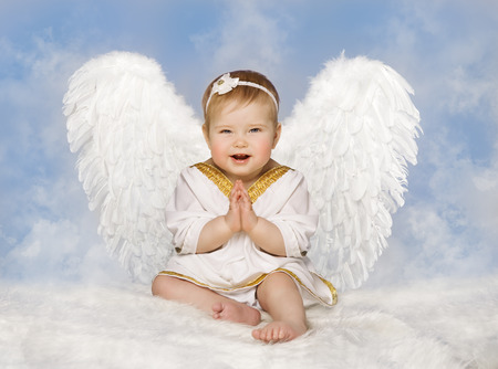 Photo for Angel Baby Wings, Angelic Cupid Toddler Kid Clasped Hands Folded, New Born Child Sitting at Blue Sky Cloud - Royalty Free Image