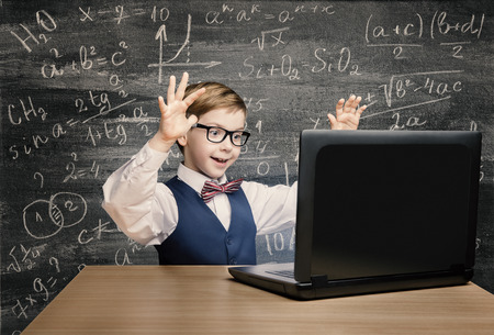 Photo for Kid Looking at Laptop, Child with Notebook, Little Boy Mathematics Formula on Chalkboard - Royalty Free Image