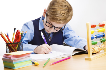 Photo pour School Kid Writing, Student Child Learn in Classroom, Young Boy in Glasses Write, Education - image libre de droit