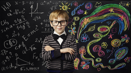 Photo for Kid Creativity Education Concept, Child Learning Art Mathematics Formula, School Boy Ideas on Black Chalk Board - Royalty Free Image
