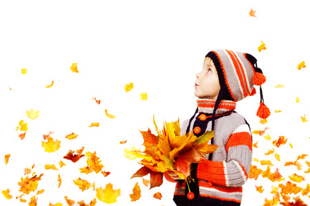 Photo for Kid Autumn Fashion, Child Knitted Hat Woolen Jacket Clothing, Boy with Fall Leaves Looking Up on White, five years old - Royalty Free Image