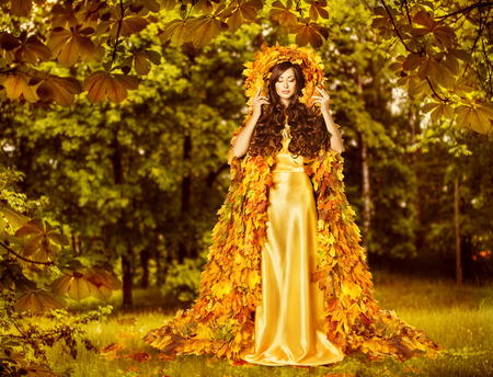 Photo for Autumn Fairy Woman in Forest, Nymph in Yellow Leaves Dress, Fantasy Goddess of Earth - Royalty Free Image