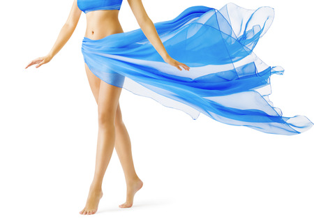 Photo pour Woman Legs, Girl in Blue Waving Dress, Smooth Skin Leg Tiptoe on White - image libre de droit