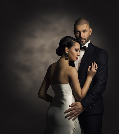 Photo for Couple in Black Suit and White Dress, Rich Man and Fashion Woman - Royalty Free Image