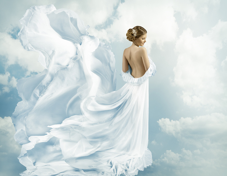 Photo for Women Fantasy Flying Gown, Waving Dress Blowing on Wind - Royalty Free Image