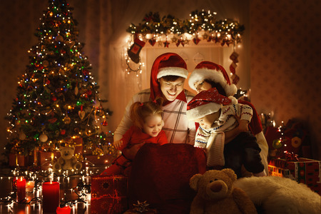 Photo for Christmas Family Open Present Gift Bag, Looking to Magic Light in Xmas Interior - Royalty Free Image