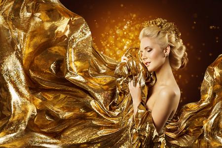 Photo pour Fashion Model Gold Fabric, Woman Face and Flying Golden Cloth, Girl Beauty Portrait - image libre de droit