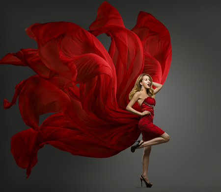 Photo pour Fashion Model Red Dress, Woman Dancing in Flying Fabric Gown, Waving Fluttering Cloth - image libre de droit