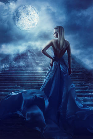 Photo for Woman Climb Up Stairs to Fantasy Moon Heaven, Fairy Girl in Night Blue Dress, Model Back View Looking over Shoulder - Royalty Free Image