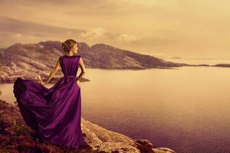 Photo for Woman in Elegant Dress on Mountain Coast, Fashion Model in Flowing Gown Cloth, Looking to Landscape View, Outdoor - Royalty Free Image