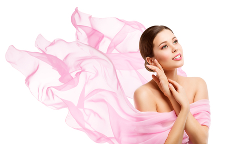 Photo for Woman Beauty, Happy Model Face Makeup, Girl looking side away in waving pink fabric, White Background - Royalty Free Image