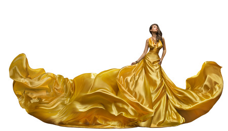 Foto de Fashion Model Dress, Woman Dance in Long Gown, Waving Golden Silk Fabric, Beautiful Girl on White - Imagen libre de derechos