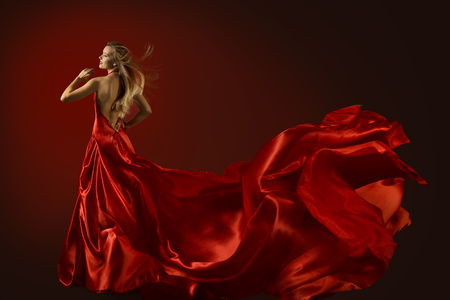 Photo for Fashion Model Dance in Red Dress, Dancing Beautiful Woman, Flying Fluttering Fabric, Happy Girl Rear Back View - Royalty Free Image