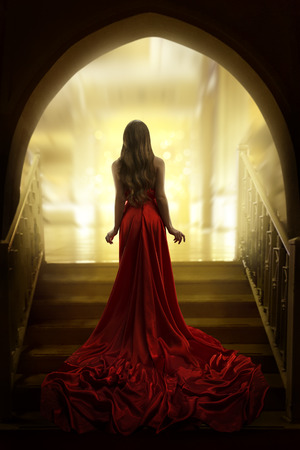 Photo pour Elegant Woman Silhouette in Long Red Gown, Lady Back Rear View, Fashion Model Dress Fabric Waving on Stairs - image libre de droit