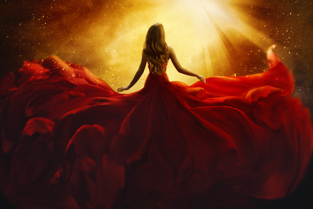 Foto per Fashion Model Back Side in Red Flying Dress, Woman Rear View, Gown Fabric Fly on Wind, Beautiful Girl Looking to Light - Immagine Royalty Free