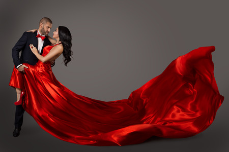 Foto de Dancing Couple, Woman in Red Dress and Elegant Man in Suit, Flying Waving Fabric - Imagen libre de derechos