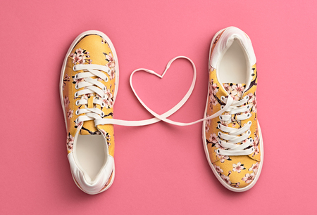 Photo pour Fashion Trendy Trainers with Heart. Woman Set. Pastel Pink Color. Minimal Style. Summer Floral Sneakers. Flat lay. Spring lady. Art Design. Love, Valentines day concept - image libre de droit