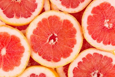 Photo pour Close up of sliced grapefruit as a background. - image libre de droit