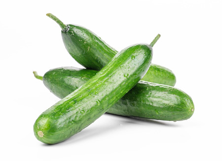 Photo pour Three fresh cucumbers. Isolated on a white background. - image libre de droit