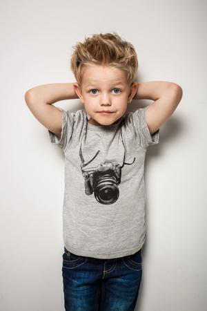 Foto de Little pretty boy posing at studio as a fashion model. Studio portrait over white background - Imagen libre de derechos