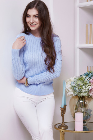Photo pour Beauty woman clever smart girl read book interview in perfect home interior comfort furniture wear casual fashion wool sweater style pants and clothes for office walk date natural makeup and sexy body - image libre de droit