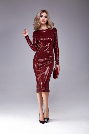 Photo pour Beautiful sexy woman wear lux skinny shine red dress shiny sequins style for party celebrate New Year Christmas beauty salon hair style makeup perfect body shape jewelry model pose fashion clothes. - image libre de droit