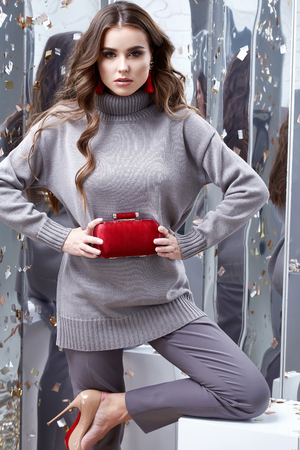 Photo pour Beautiful sexy young business woman brunette hair luxury chic wear casual style for office grey  organic sweater trousers pretty face spring winter collection glamor model fashion clothes jewelry bag. - image libre de droit