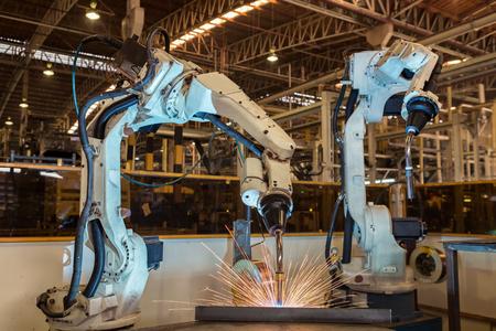 Photo pour Industrial robot are test run new program in automotive assembly factory - image libre de droit