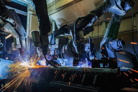 Foto de Team robots welding assembly automotive part - Imagen libre de derechos