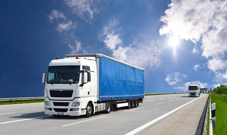 Foto per Truck transports goods by road - shipping and logistics  - Immagine Royalty Free