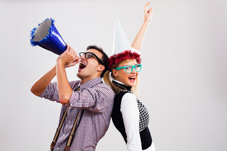 Photo for Nerdy man and nerdy woman are having party. - Royalty Free Image