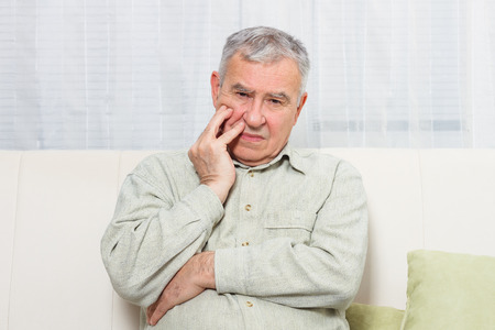 Photo for Senior man is having toothache. - Royalty Free Image