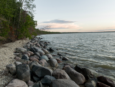 Photo for Rocks along shoreline, Lake Winnipeg, Riverton, Hecla Grindstone Provincial Park, Manitoba, Canada - Royalty Free Image