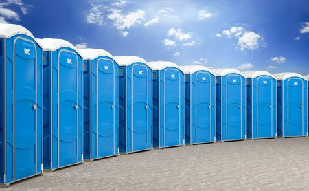 Foto de 3d illustration of a group of mobile blue bio toilets. - Imagen libre de derechos