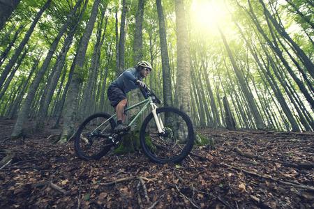 Photo pour Rider in action at Freestyle Mountain Bike Session - image libre de droit