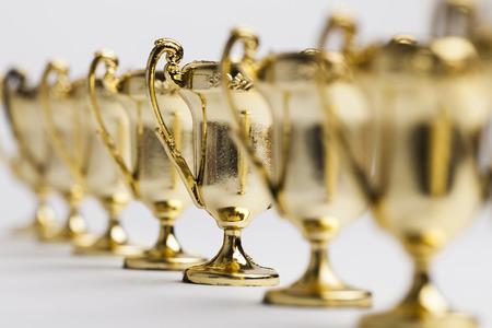 Photo pour Gold winners achievement trophy background - image libre de droit