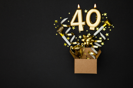 Photo for Number 40 gold celebration candle and gift box background - Royalty Free Image