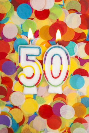 Photo for Celebration candle number 50 on a confetti background - Royalty Free Image