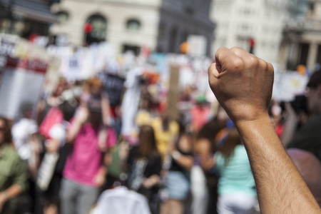 Photo for A raised fist of a protestor at a political demonstration - Royalty Free Image