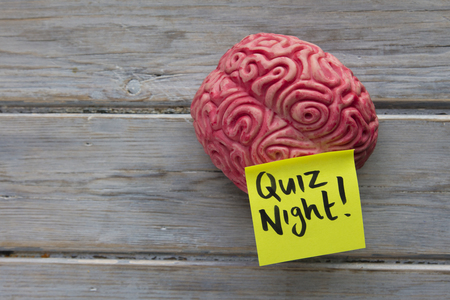 Photo for Quiz night label stuck on a brain - Royalty Free Image