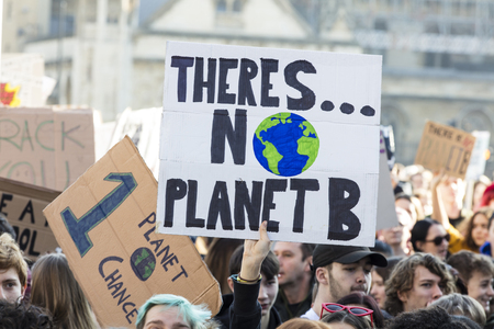 Photo for LONDON, UK - February 15, 2019: Protestors with banners at a Youth strike for climate march in central London - Royalty Free Image