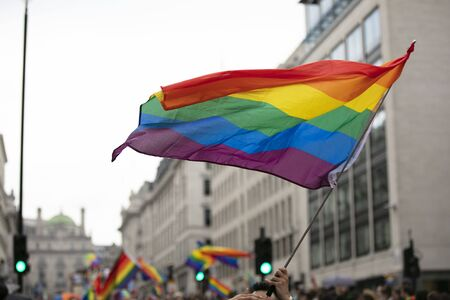 Photo for Gay pride, LGBTQ rainbow flags being waved in the air at a pride event - Royalty Free Image