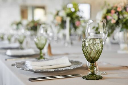 Photo pour Table served with glasses, plate, forks and knives. Served festive table ready for guests. Luxury wedding table - image libre de droit