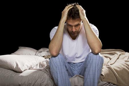 Foto de young man unable sleep because of stress of problems - Imagen libre de derechos